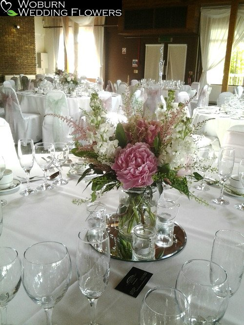 Vase arrangement of Stocks and Peonies at Woburn Safari Lodge.