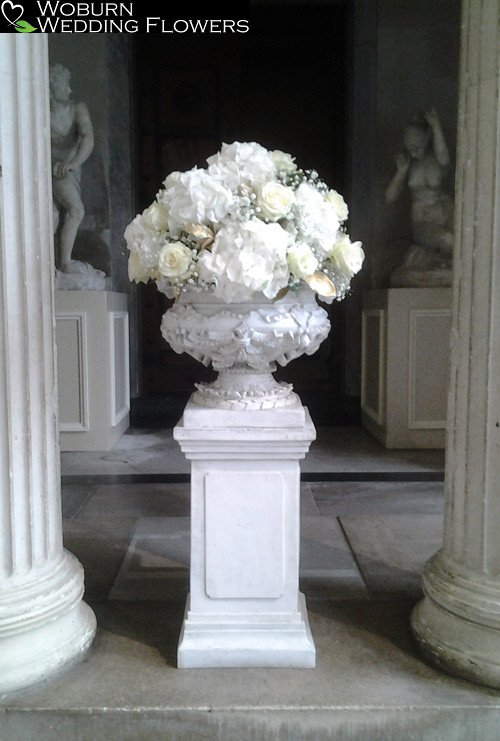 Urn arrangement of Hydrangea, Roses and Gypsophillia at Woburn Sculpture Gallery.