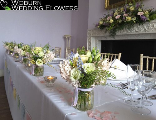 Spring flower arrangements in glass jars at Moggerhanger Park.