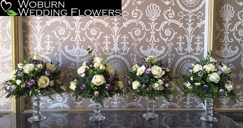 Rose and Lizzianthus crystal stand arrangements at Wrest Park.