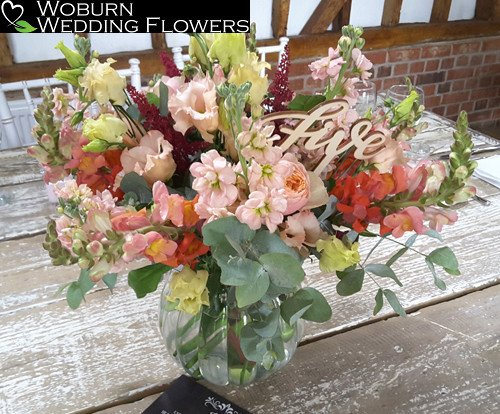 Rose, Astilbe, Snapdragon, Stocks and Lizzianthus in glass jar at the Milling Barn.