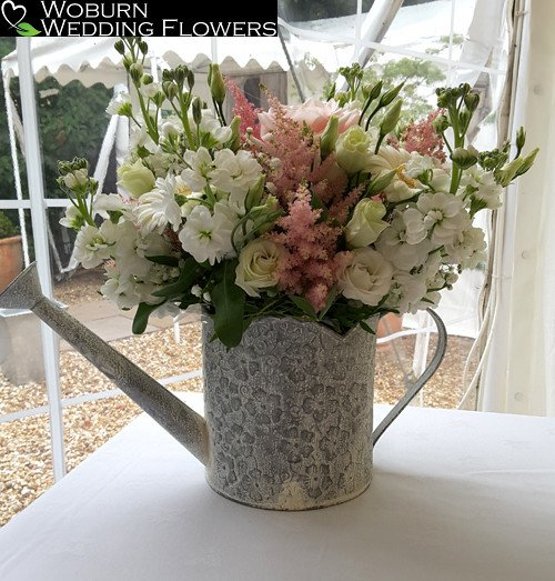 Stocks, Astilbe, Lizzianthus and Rose arrangement in watering can.