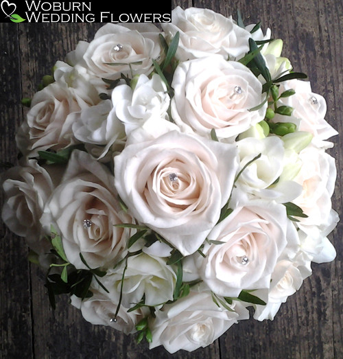 Rose and double Freesia hand tied bouquet.