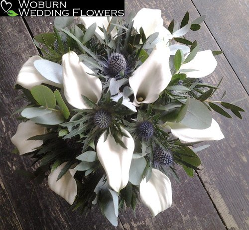 Calla Lilly and Thistle hand tied bouquet.