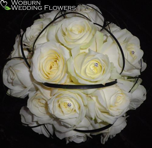 Rose and steel grass hand tied bouquet.